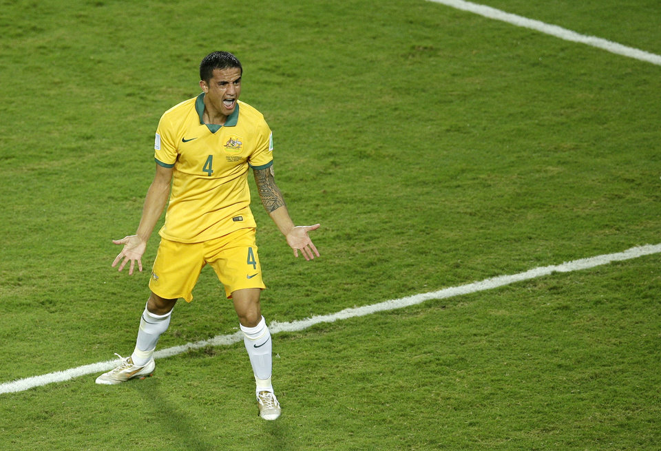 Photo - Australia's Tim Cahill reacts as the referee disallowes a goal during the group B World Cup soccer match between Chile and Australia in the Arena Pantanal in Cuiaba, Brazil, Friday, June 13, 2014. (AP Photo/Michael Sohn)