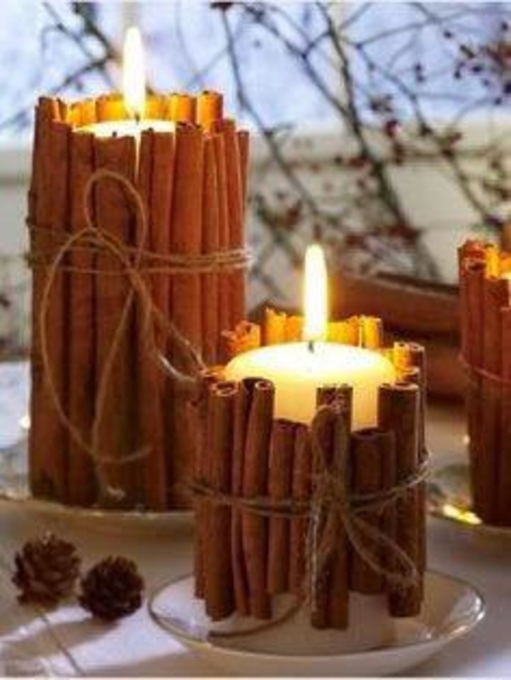 Photo - Bring in the aroma of the season with these beautiful candles, featured on http://fitmommydiaries.blogspot.com. Using twine, tie fresh cinnamon sticks of varied lengths around a vanilla-scented candle. Photo provided.
