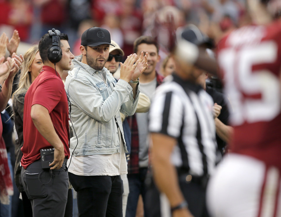 Photo - Former Oklahoma quarterback Baker Mayfield claps after an Oklahoma touchdown during a college football game between the University of Oklahoma Sooners (OU) and the Army Black Knights at Gaylord Family-Oklahoma Memorial Stadium in Norman, Okla., Saturday, Sept. 22, 2018. Photo by Bryan Terry, The Oklahoman