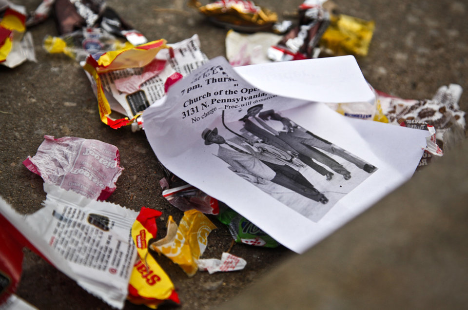 Photo - Trash gathers along the street during the Martin Luther King Jr. parade in downtown on Monday, Jan. 17, 2011, in Oklahoma City, Okla. .  