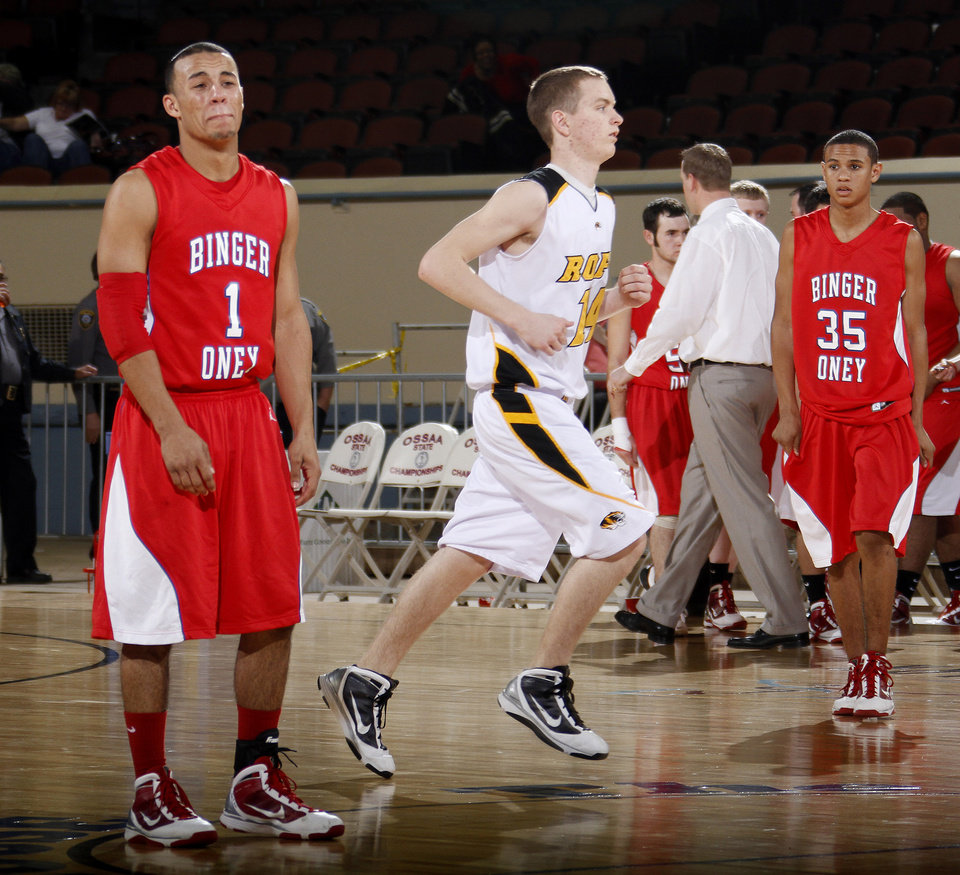 Photo - Binger-Oney's Tevin Johnson, left, and Kalen Johnson react to their loss  as Roff's Shane Wise leaves the court during the Class B boys basketball state tournament at the State Fair Arena in Oklahoma City, Friday, March 5, 2010.  Photo by Bryan Terry, The Oklahoman