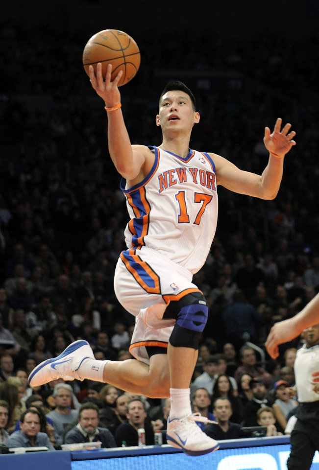 Photo -   FILE - In this Feb. 4, 2012, file photo, New York Knicks' Jeremy Lin drives to the basket during the second quarter of an NBA basketball game New Jersey Nets at Madison Square Garden in New York. Linsanity could be put to rest in New York when the clock strikes midnight. That's the deadline the Knicks face to match the daunting offer the Houston Rockets have made to Lin, the Harvard point guard who dazzled all of basketball for a brief stretch last season. (AP Photo/Bill Kostroun, File)