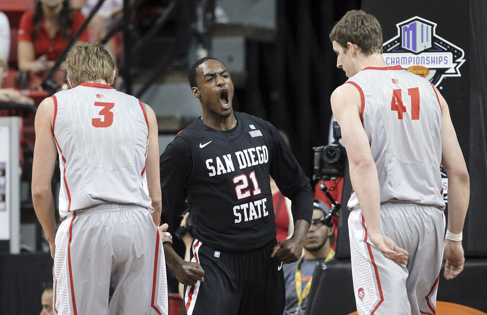 Photo - San Diego State's Jamaal Franklin, center, reacts after dunking during the first half of a Mountain West Conference tournament NCAA college basketball game against New Mexico on Friday, March 15, 2013, in Las Vegas. (AP Photo/Isaac Brekken) ORG XMIT: NVIB102