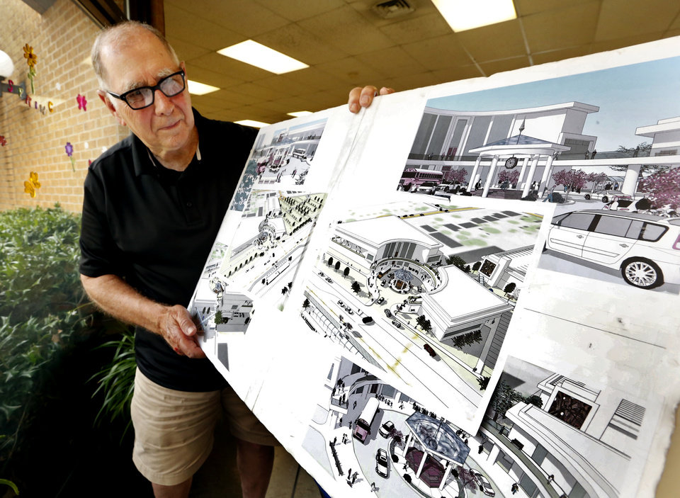 Photo -  Will Decker shows a drawing of a design for a stand-alone senior citizens center next to a new library. Decker is leading a petition drive to get a stand-alone center. [PHOTO BY STEVE SISNEY, THE OKLAHOMAN]