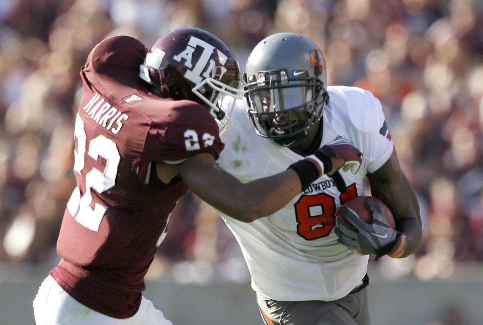 Oklahoma State's Justin Blackmon (81) tries get by Texas A&M's Dustin Harris (22) in the second half of OSU's 30-29 win on Saturday in College Station, Texas. Photo by Sarah Phipps, The Oklahoman