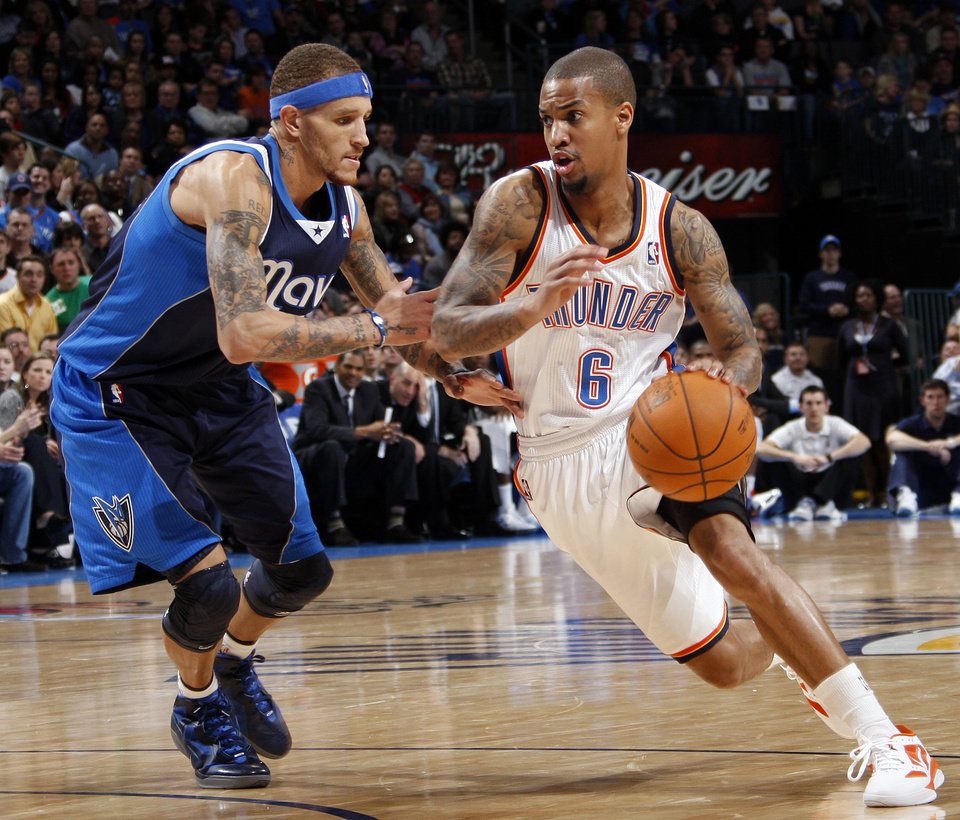 Oklahoma City's Eric Maynor (6) drives the ball past Delonte West (13) of Dallas in the second half during an NBA basketball game between the Oklahoma City Thunder and the Dallas Mavericks at Chesapeake Energy Arena in Oklahoma City, Thursday, Dec. 29, 2011. Oklahoma City won, 104-102. Photo by Nate Billings, The Oklahoman