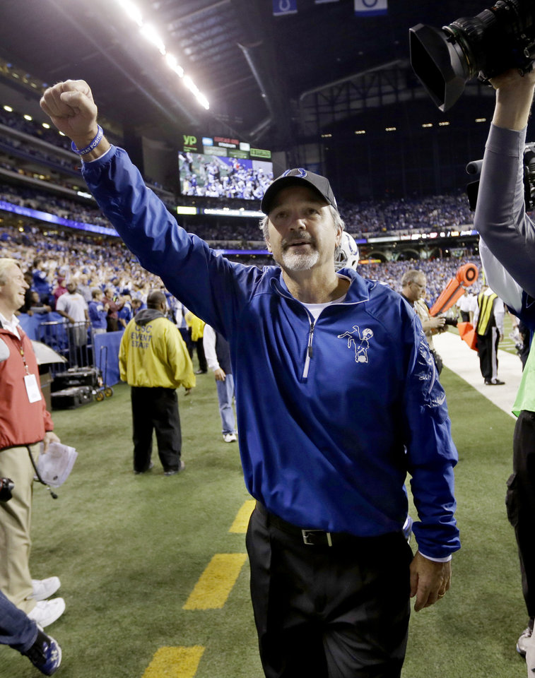 Photo - Indianapolis Colts head coach Chuck Pagano celebrates after an NFL wild-card playoff football game Saturday, Jan. 4, 2014, in Indianapolis. Indianapolis defeated Kansas City 45-44. (AP Photo/Michael Conroy)