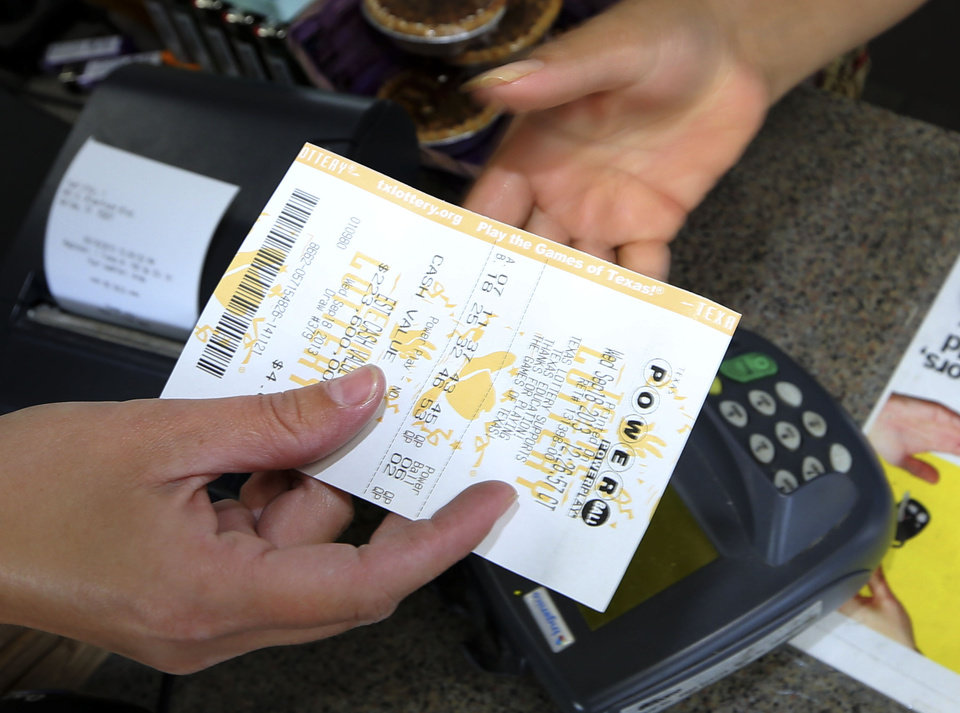Photo - A Powerball lottery ticket is purchased at the Fuel City store in Dallas on Wednesday, Sept. 18, 2013. For Wednesday's drawing, Powerball's estimated $400 million jackpot will be the nation's fifth-largest ever. (AP Photo/LM Otero)