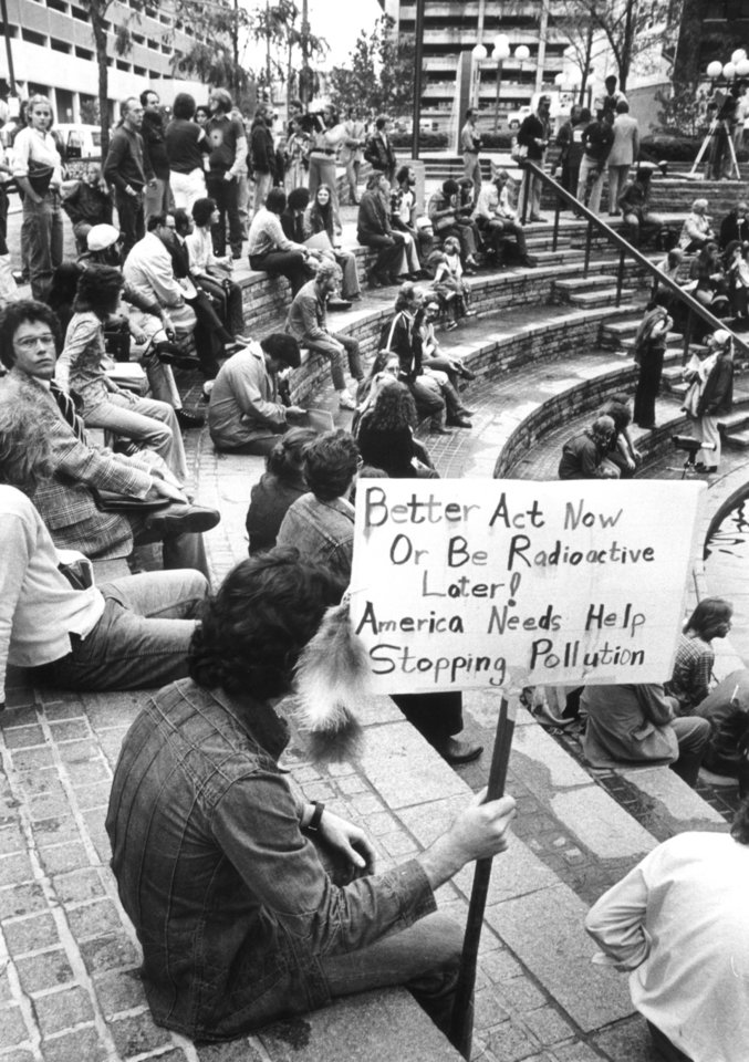 Photo - Greg Blott of OKC holds sign during Silkwood memorial activities at Kerr Park in this Nov 13, 1978 photo. Karen Silkwood was a Kerr McGee employee that worked at the plutonium plant near Cresent and the Cimmaron River.