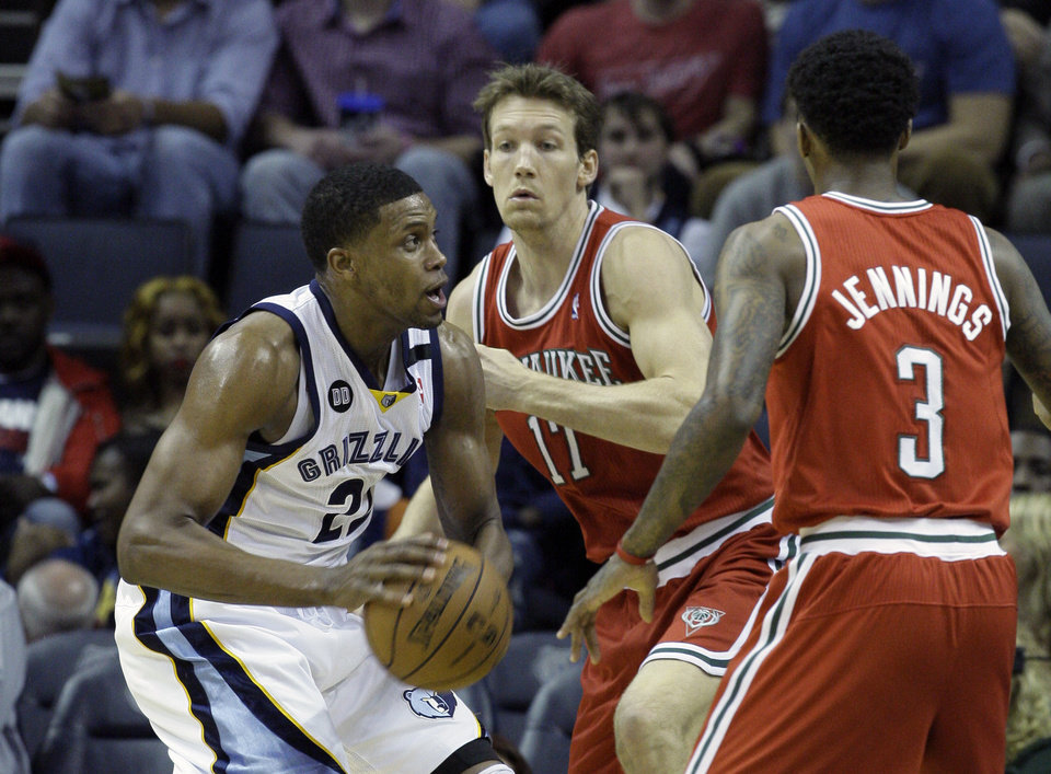 Photo - Memphis Grizzlies' Rudy Gay (22) is guarded by Milwaukee Bucks' Mike Dunleavy (17) and Brandon Jennings (3) during the first half of an NBA basketball game in Memphis, Tenn., Wednesday, Dec. 19, 2012. (AP Photo/Danny Johnston)