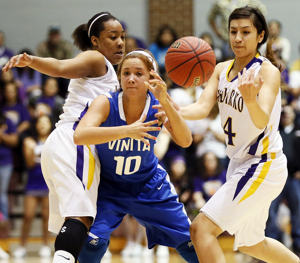 Vinita's Kamry Chamberlain (10) loses the ball between Anadarko's Tandra King (2), left, and Ashley Beatty (14) during a Class 4A girls high school basketball game in the first round of the state tournament at the Sawyer Center on the campus of Southern Nazarene University in Bethany, Okla., Thursday, March 7, 2013. Anadarko won, 51-45. Photo by Nate Billings, The Oklahoman