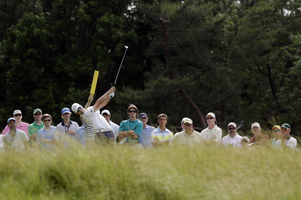 Photo - Zach Johnson tees off on the eighth hole during practice for the U.S. Open golf tournament at Merion Golf Club, Wednesday, June 12, 2013, in Ardmore, Pa. (AP Photo/Gene J. Puskar)