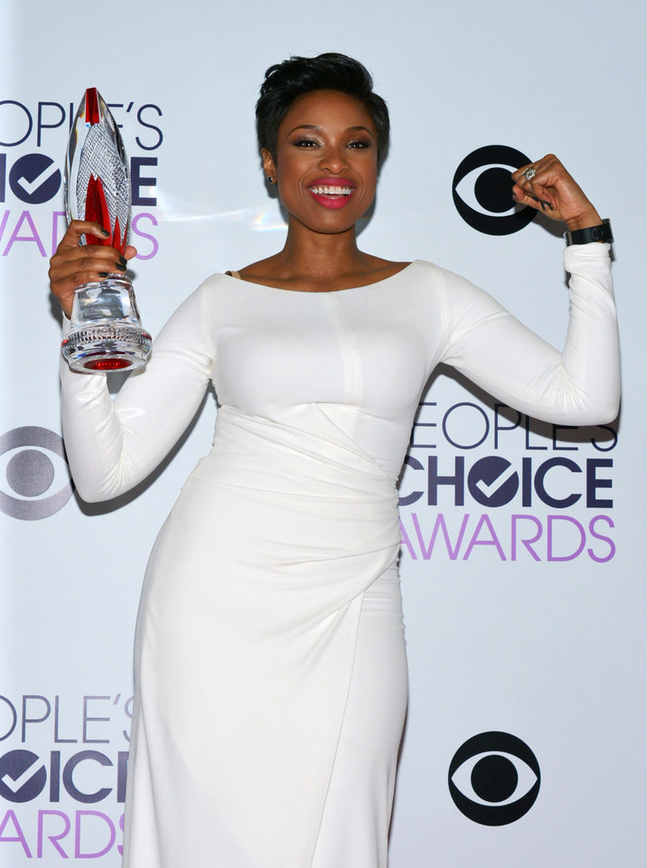 Photo - Jennifer Hudson poses in the press room with the award for favorite humanitarian at the 40th annual People's Choice Awards at Nokia Theatre L.A. Live on Wednesday, Jan. 8, 2014, in Los Angeles. (Photo by John Shearer/Invision/AP)