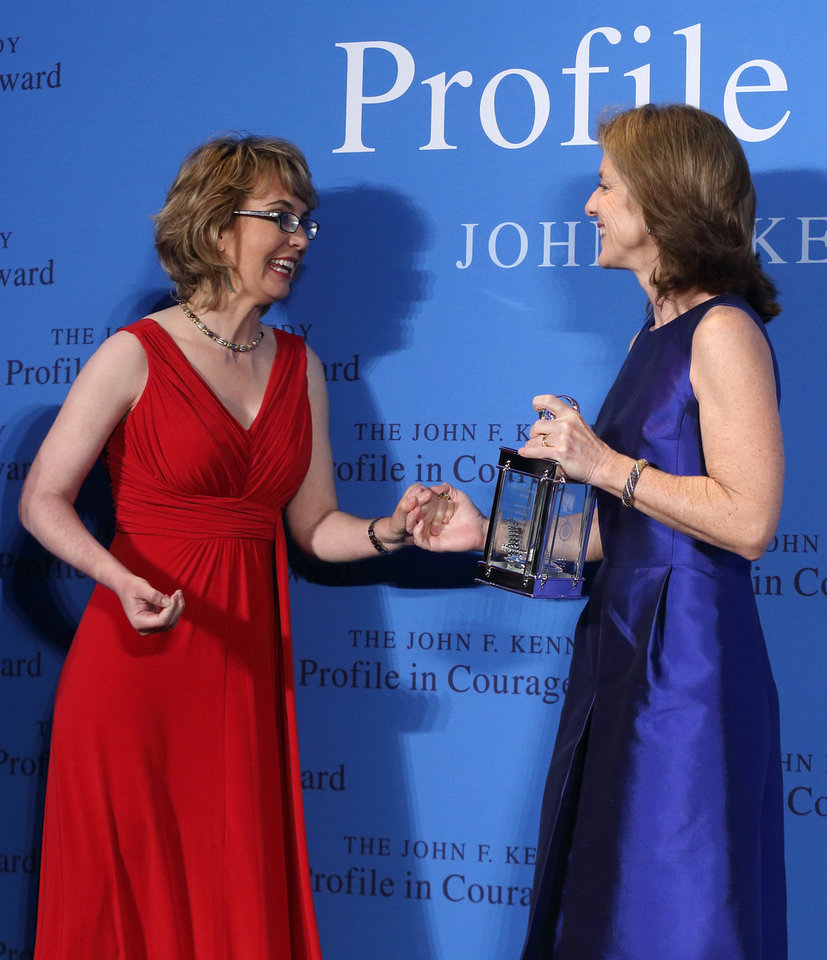 Photo - Caroline Kennedy, right, presents former Arizona congresswoman Gabrielle Giffords the John F. Kennedy Profile in Courage Award at the JFK Library in Boston, Sunday, May 5, 2013. (AP Photo/Michael Dwyer)