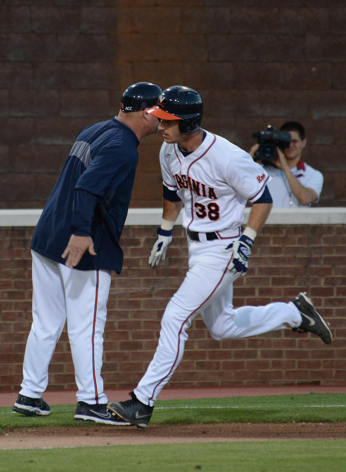 Photo - Virginia's Mike Papi (38) rounds third after hitting a two-run home run during the first inning of an NCAA college baseball regional tournament game against Arkansas in Charlottesville, Va., Saturday, May 31, 2014. (AP Photo/Pat Jarrett)