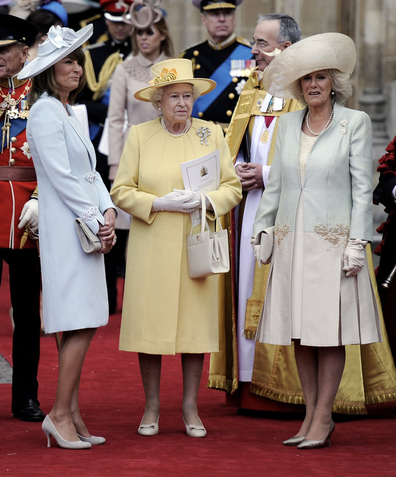 Photo - Britain's Queen Elizabeth II is flanked by Carole Middleton, left, and Camilla, Duchess of Cornwall outside of Westminster Abbey after the Royal Wedding in London Friday, April, 29, 2011. (AP Photo/Martin Meissner)