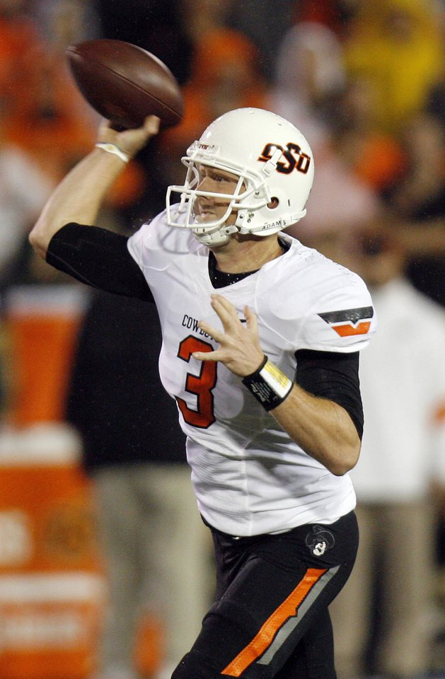Photo - OSU's Brandon Weeden (3) passes the ball in the second quarter during a college football game between the Oklahoma State University Cowboys and the University of Tulsa Golden Hurricane at H.A. Chapman Stadium in Tulsa, Okla., Sunday morning, Sept. 18, 2011. Photo by Nate Billings, The Oklahoman