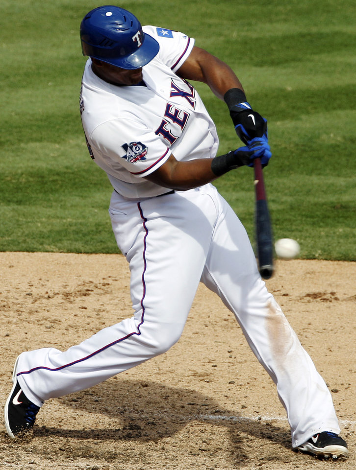 Photo -   Texas Rangers' Adrian Beltre (29) connects for a single off a pitch from Oakland Athletics' Pedro Figueroa in the sixth inning of a baseball game, Thursday, Sept. 27, 2012, in Arlington, Texas. (AP Photo/Tony Gutierrez)