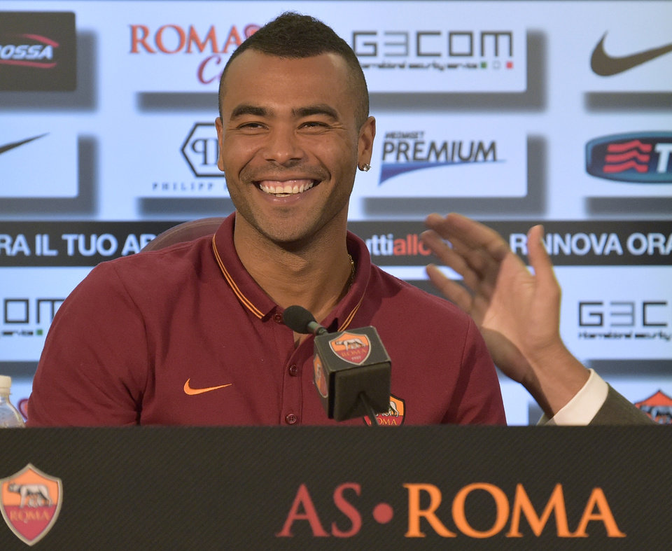Photo - Former Chelsea left back Ashley Cole attends a press conference during the official presentation in Rome Tuesday, July 15, 2014. Cole signed a two-year deal with Roma last week and was presented with the Giallorossi's No. 3 shirt Tuesday. The 33-year-old Cole spent the past eight seasons with Chelsea, and was with London rival Arsenal for the previous six years. (AP Photo/Alfredo Falcone, Lapresse) ITALY OUT