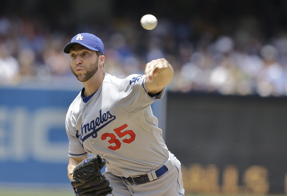 Photo - Los Angeles Dodgers starting pitcher Chris Capuano works against the San Diego Padres in the first inning of a baseball game in San Diego, Sunday, June 23, 2013. (AP Photo/Lenny Ignelzi)
