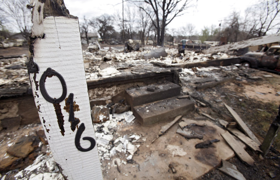 Photo - The house numbers are one of the few salvageable remains from a house that was destroyed by wildfires on Friday, April 10, 2009, in Choctaw, Okla.  Photo by Chris Landsberger, The Oklahoman