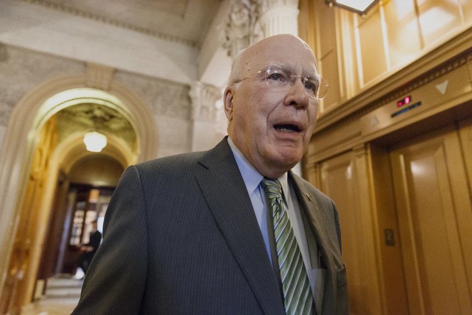 Photo - Senate Judiciary Committee Chairman Sen. Patrick Leahy, D-Vt. leaves the Senate chamber on Capitol Hill in Washington, Tuesday, March 11, 2014, after speaking in support of Senate Intelligence Committee Chair Sen. Dianne Feinstein, D-Calif., who accused the CIA of undermining congressional oversight and the separation of powers under the Constitution.  (AP Photo/J. Scott Applewhite)