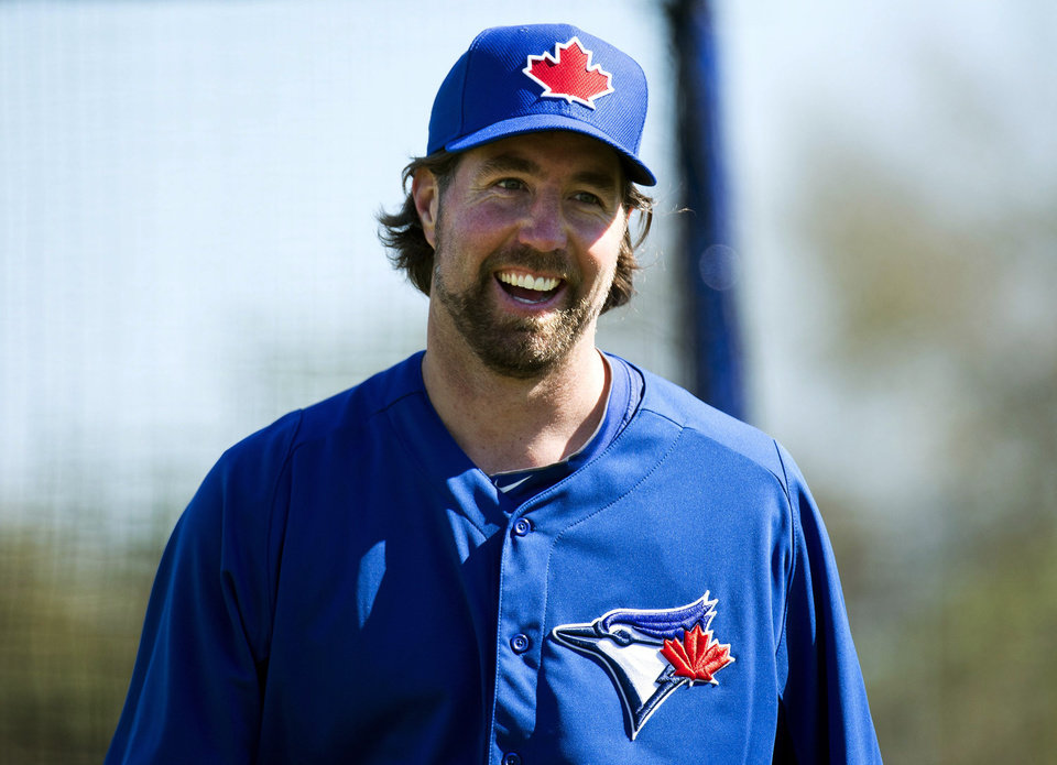 Toronto Blue Jays starting pitcher R.A. Dickey smiles after working his first live batting practice during baseball spring training in Dunedin, Fla., Sunday, Feb. 17, 2013. (AP Photo/The Canadian Press, Nathan Denette)