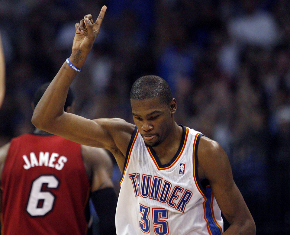 Photo - Oklahoma City's Kevin Durant (35) celebrates a shot during the NBA basketball game between the Miami Heat and the Oklahoma City Thunder at Chesapeake Energy Arena in Oklahoma City, Sunday, March 25, 2012. Photo by Sarah Phipps The Oklahoman