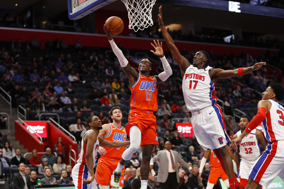 Photo - Oklahoma City Thunder guard Dennis Schroder, left, drives on Detroit Pistons forward Tony Snell, right, in the second half of an NBA basketball game in Detroit, Wednesday, March 4, 2020. (AP Photo/Paul Sancya)