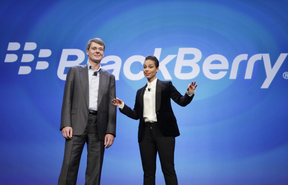 Photo - Thorsten Heins, CEO of Research in Motion, introduces Alicia Keys as the Global Creative director of BlackBerry, Wednesday, Jan. 30, 2013 in New York. The maker of the BlackBerry smartphone is promising a speedy browser, a superb typing experience and the ability to keep work and personal identities separate on the same phone, the fruit of a crucial, long-overdue makeover for the Canadian company. (AP Photo/Mark Lennihan)