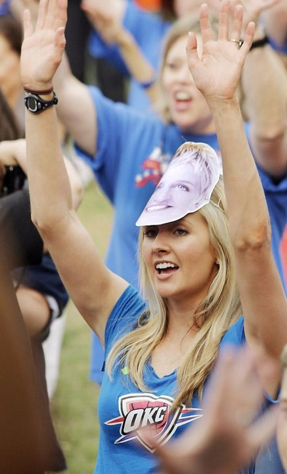 Photo -  Leah Sparks learns the dance steps with an Ellen mask on her head during a Thunder mob dance to send to Ellen DeGeneres at Hafer Park in Edmond Wednesday, May 18, 2011. Photo by Doug Hoke, The Oklahoman. ORG XMIT: KOD