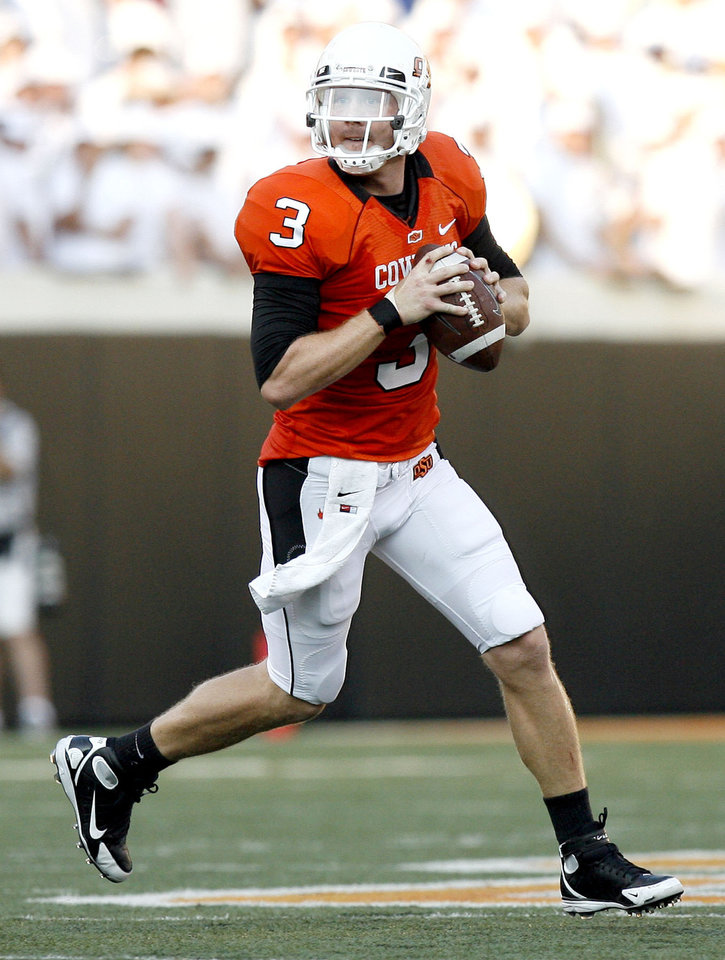Oklahoma State quarterback Brandon Weeden (3) looks to throw a pass during the college football game between the University of Tulsa (TU) and Oklahoma State University (OSU) at Boone Pickens Stadium in Stillwater, Oklahoma, Saturday, September 18, 2010. Photo by Sarah Phipps, The Oklahoman