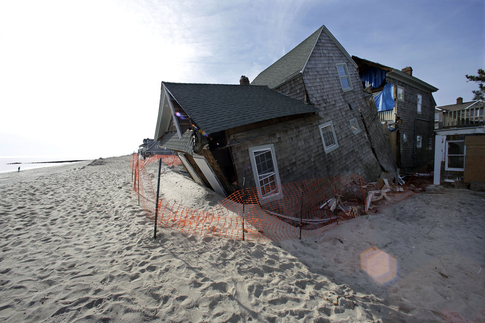 A beach front home that was severely damaged two months ago by Superstorm Sandy rests in the sand in Bay Head, N.J., Thursday, Jan. 3, 2013. New Jersey Gov. Chris Christie, a Republican who has praised President Barack Obama\'s handling of Superstorm Sandy, has blasted U.S. House Speaker John Boehner for delaying a vote for federal storm relief. Now, under intense pressure from angry Republicans, House Speaker John Boehner has agreed to a vote this week on aid for Superstorm Sandy recovery. (AP Photo/Mel Evans)