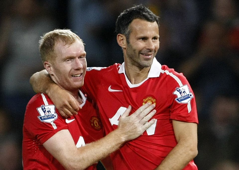 Photo - FILE - This is a Monday, Aug. 16, 2010 file photo Manchester United's Ryan Giggs, right,  with teammate Paul Scholes after scoring a goal against Newcastle United during their English Premier League soccer match at Old Trafford, Manchester, England.  Ryan Giggs will be assisted by former teammates Paul Scholes, Nicky Butt and Phil Neville during his spell as interim manager of Manchester United following the dismissal of David Moyes. (AP Photo/Tim Hales, File)