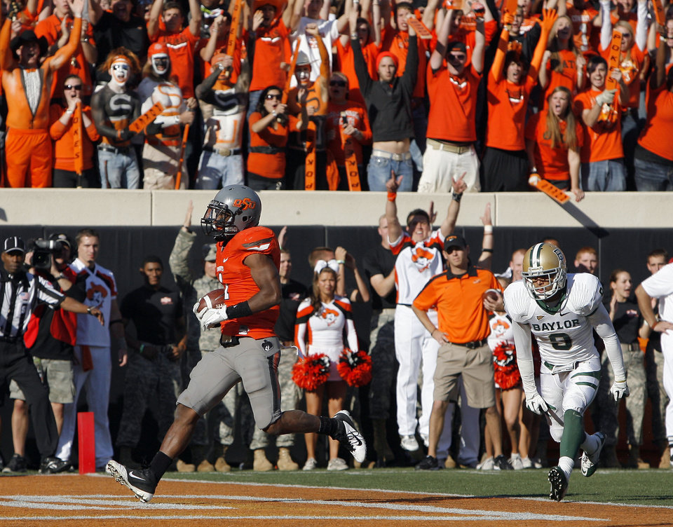 Photo - Oklahoma State's Joseph Randle (1) scores a touchdown in front of Baylor's Chance Casey (9) during a college football game between the Oklahoma State University Cowboys (OSU) and the Baylor University Bears (BU) at Boone Pickens Stadium in Stillwater, Okla., Saturday, Oct. 29, 2011. Photo by Sarah Phipps, The Oklahoman