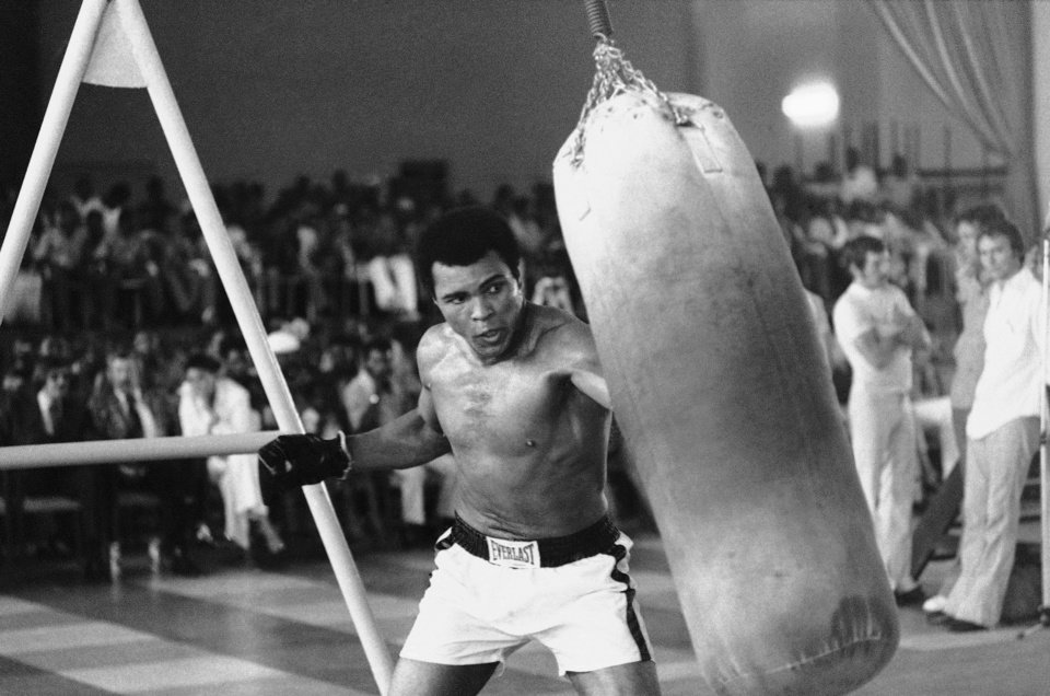 Photo -   FILE - In this October 1974 file photo taken by Associated Press photographer, Muhammad Ali works out before his bout against George Foreman in Zaire. Faas, a prize-winning combat photographer who carved out new standards for covering war with a camera and became one of the world's legendary photojournalists in nearly half a century with The Associated Press, Thursday May 10, 2012. He was 79. (AP Photo/Horst Faas, File)