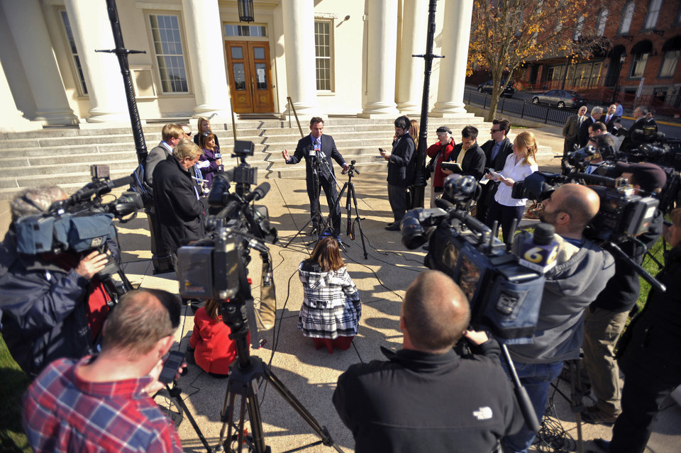 Photo - Penn State trustee Anthony Lubrano, center, speaks to the media after a court hearing at the Centre County Courthouse, Tuesday, Oct. 29, 2013,  in Bellefonte, Pa. Lawyers for the NCAA, the Paterno family and Paterno supporters were at the Centre County Courthouse, Tuesday for a court hearing on whether to allow a lawsuit filed against the NCAA by the family of longtime Penn State football coach Joe Paterno and others to go forward. The lawsuit brought by the Paterno family aims to wipe out the NCAA sanctions against Penn State University.  (AP Photo/Centre Daily Times, Nabil K. Mark) MAGS OUT MANDATORY CREDIT