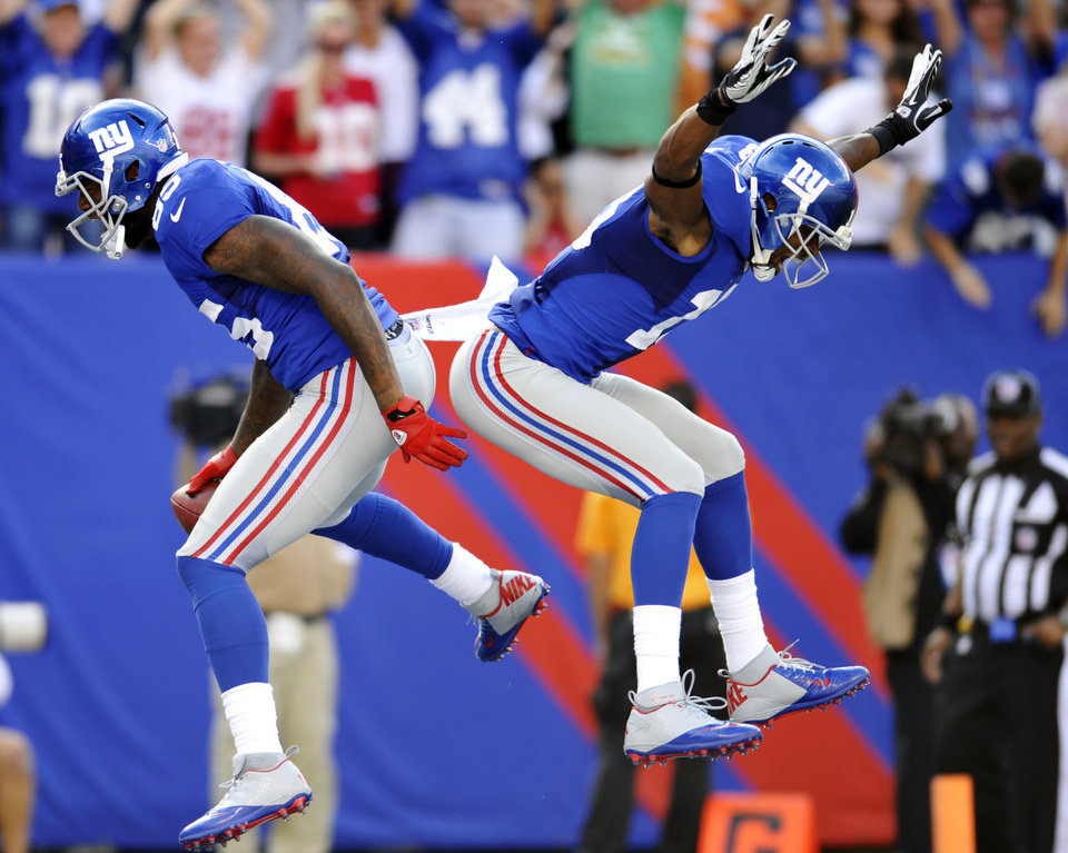 Photo -   New York Giants' Martellus Bennett, left, celebrates with Ramses Barden (13) after Bennett scored a touchdown during the second half of an NFL football game against the Tampa Bay Buccaneers, Sunday, Sept. 16, 2012, in East Rutherford, N.J. The Giants won 41-34. (AP Photo/Bill Kostroun)