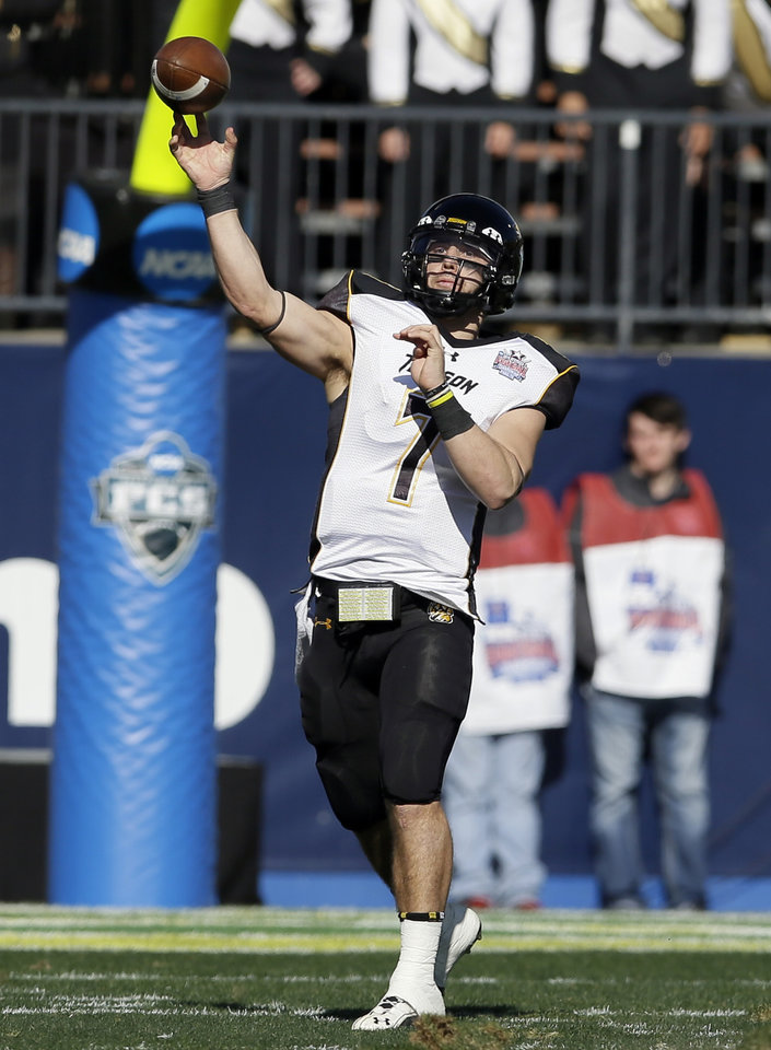 Photo - Towson quarterback Peter Athens (7) passes in the first half of the FCS championship NCAA college football game against North Dakota State, Saturday, Jan. 4, 2014, in Frisco, Texas. (AP Photo/Tony Gutierrez)
