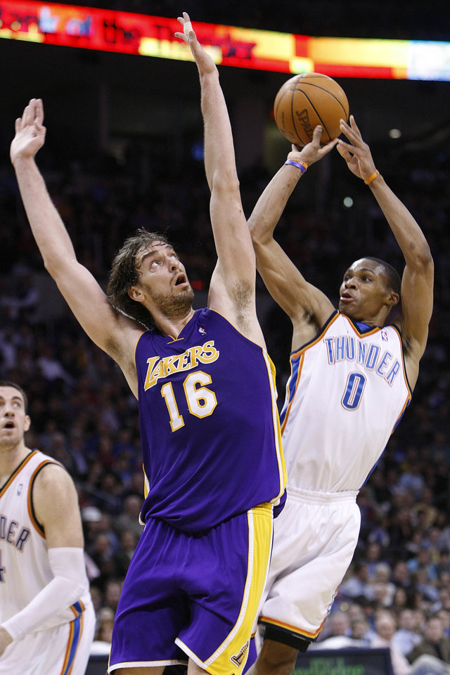 Photo - L.A. LAKERS / OKLAHOMA CITY THUNDER / LOS ANGELES LAKERS / NBA BASKETBALL  Oklahoma City Thunder guard Russell Westbrook shoots over L.A. center Pau Gasol during the Thunder - Lakers game March 26, 2010 in the Ford Center in Oklahoma City.    BY HUGH SCOTT, THE OKLAHOMAN ORG XMIT: KOD