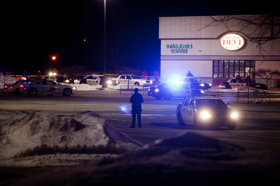 Photo - Emergency personnel respond to a shooting inside Martin's Supermarket in Elkhart, Ind., late Wednesday, Jan. 15, 2014.   A man fatally shot two women inside the grocery store and was lining up to shoot a third person when police officers tracked him down and killed him, authorities said. Elkhart police received a call about a gunman at Martin's Super Market about 10 p.m. Wednesday, Indiana State Police Sgt. Trent Smith said Thursday. The 22-year-old gunman used a semi-automatic handgun to shoot and kill a 20-year-old employee and a 44-year-old shopper, Smith said. The victims' bodies were found about 12 aisles apart. (AP Photo/The Elkhart Truth, Jon Garcia)