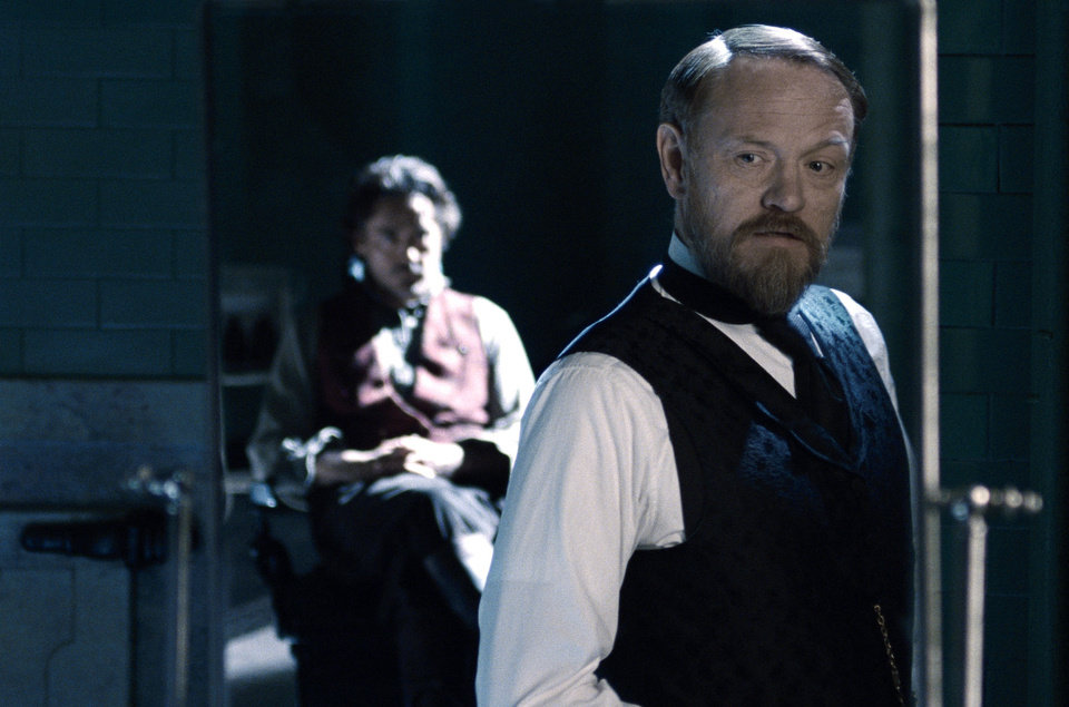 "In this film image released by Warner Bros. Pictures, Robert Downey Jr., left, and Jared Harris are shown in a scene from ""Sherlock Holmes: A Game of Shadows."" (AP Photo/Warner Bros. Pictures)  ORG XMIT: NYET215"