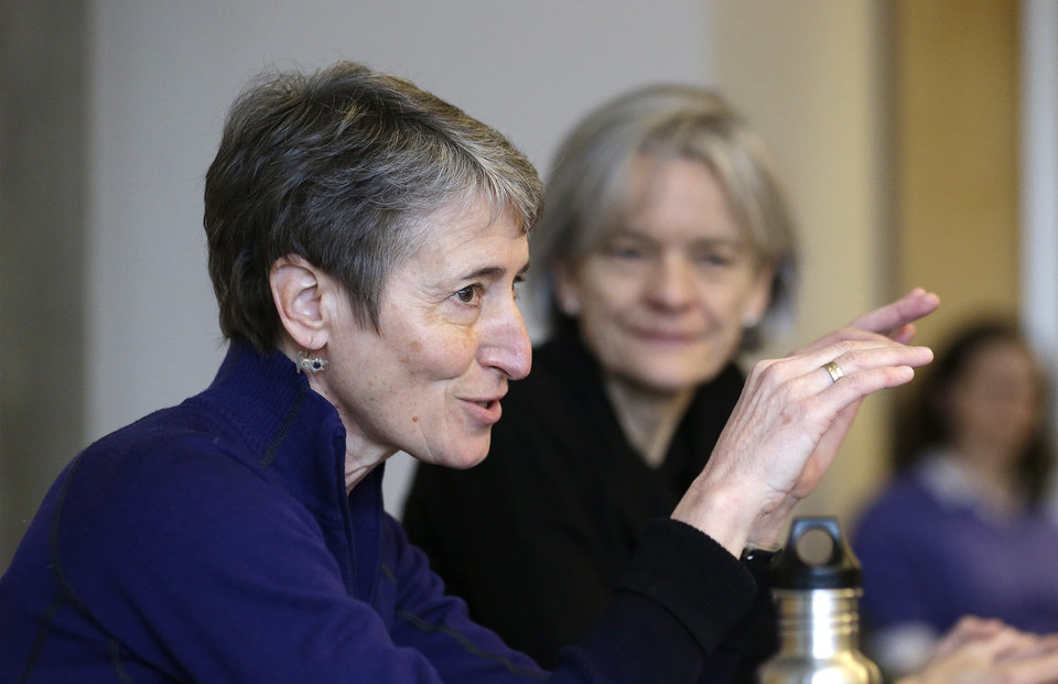 Photo - U.S. Interior Secretary Sally Jewell leads a roundtable discussion at the University of Washington's College of the Environment, Tuesday, Feb. 4, 2014, in Seattle. As part of President Obama's Climate Action Plan to cut carbon pollution, develop domestic clean energy sources and create American jobs, the gathering focused on climate change impacts to the Pacific Northwest. (AP Photo/Elaine Thompson)