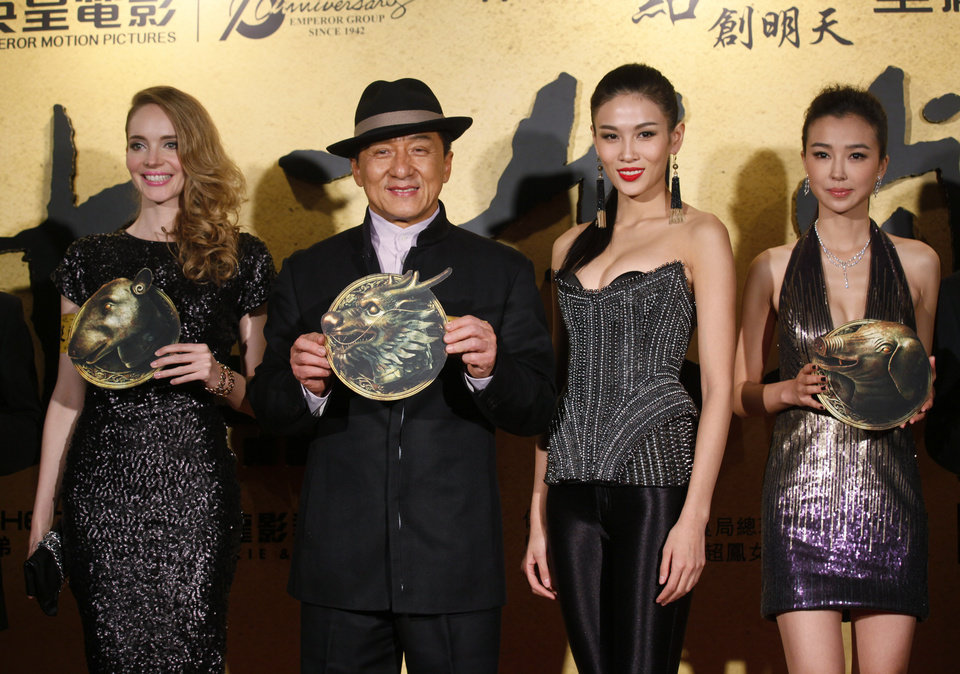 Photo - From left, French actress Laure Weissbecker, Hong Kong movie star Jackie Chan, Chinese actresses Zhang Lanxin and Yao Xingtong pose for photographers during the charity premiere of his new movie