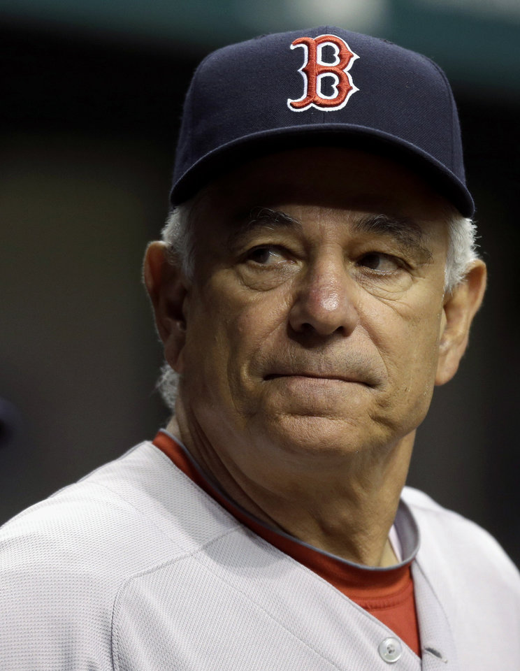 Photo -   Boston Red Sox manager Bobby Valentine looks out of the dugout during the first inning of a baseball game against the Tampa Bay Rays, Monday, Sept. 17, 2012, in St. Petersburg, Fla. (AP Photo/Chris O'Meara)