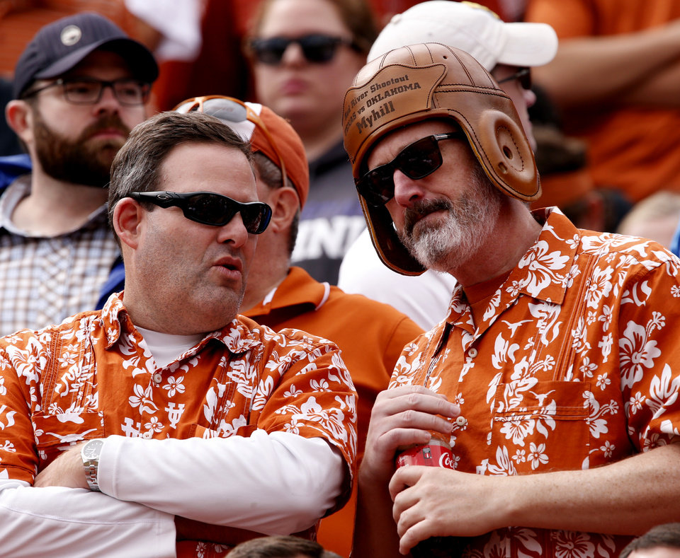 Photo - Texas fans watch during the second half of the Red River Showdown college football game between the University of Oklahoma Sooners (OU) and the University of Texas Longhorns (UT) at the Cotton Bowl in Dallas, Texas on Saturday, Oct. 11, 2014. 