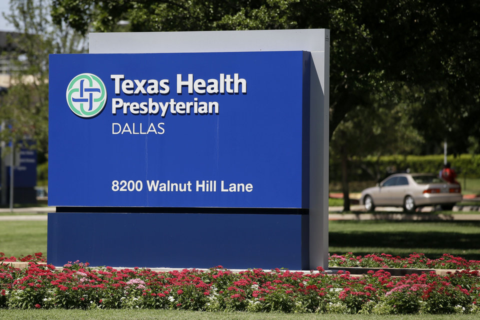 Photo - A sign marks the Texas Health Presbyterian Hospital where former President George W. Bush underwent a heart procedure  Tuesday, Aug. 6, 2013, in Dallas, after doctors discovered a blockage in an artery. Bush spokesman Freddy Ford says a stent was inserted  after the blockage was discovered Monday during Bush's annual physical. (AP Photo/Tony Gutierrez)