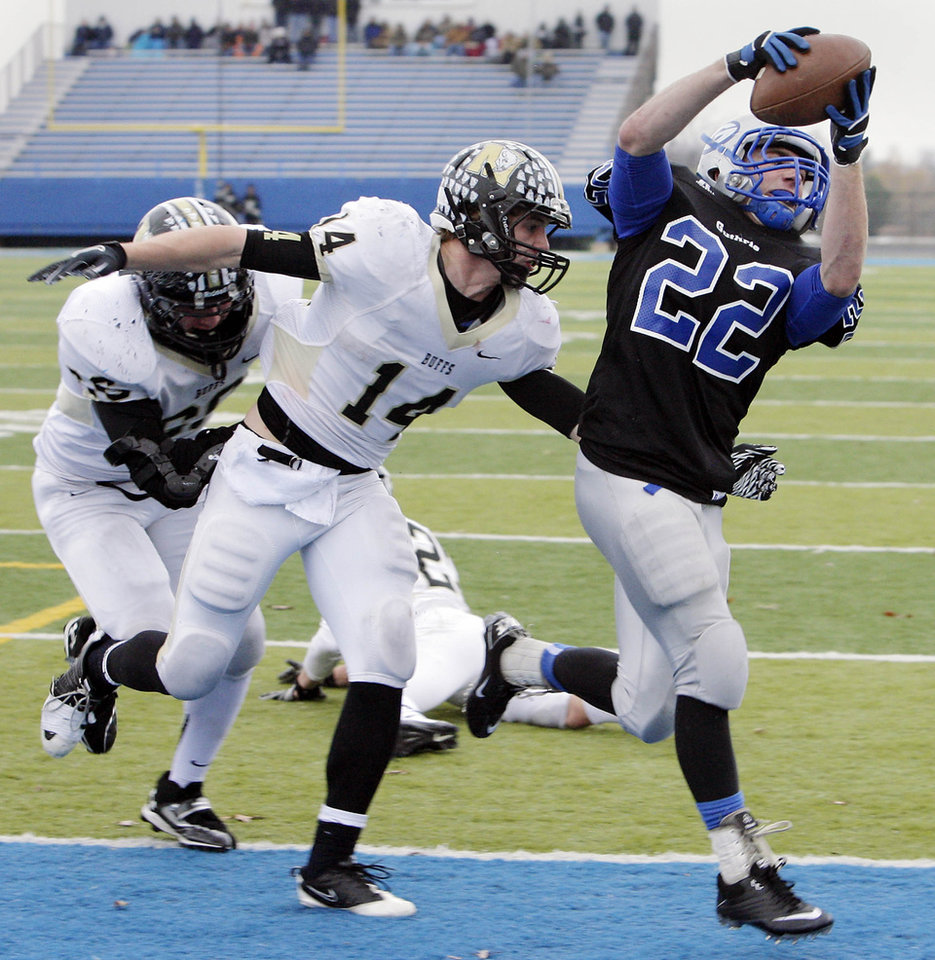 McAlester's Jesse Lane and Adam Boyd can't stop Guthrie's Luke Davis as he scores a two point conversion in the fourth period of their 5A semifinal game at Sapulpa, OK, Nov. 26, 2011. MICHAEL WYKE/Tulsa World