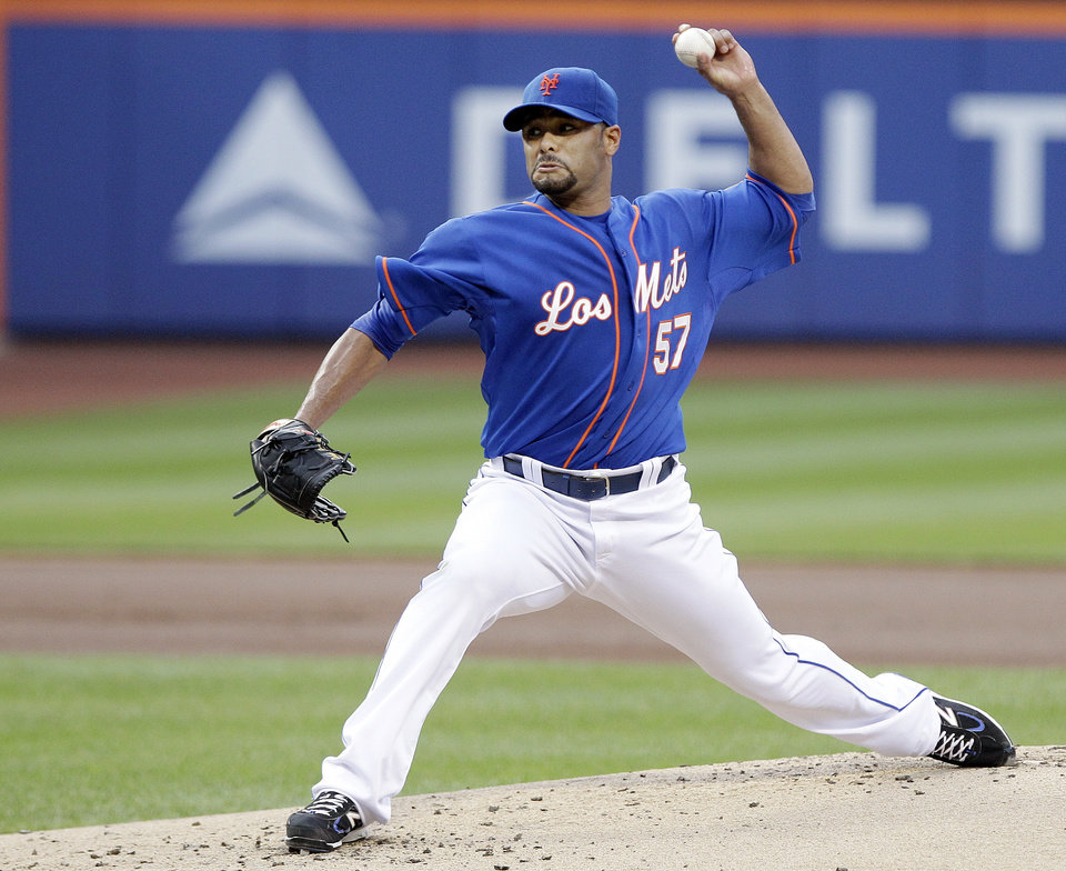 New York Mets' Johan Santana delivers a pitch during the first inning of a baseball game against the Chicago Cubs on Friday, July 6, 2012, in New York. (AP Photo/Frank Franklin II)