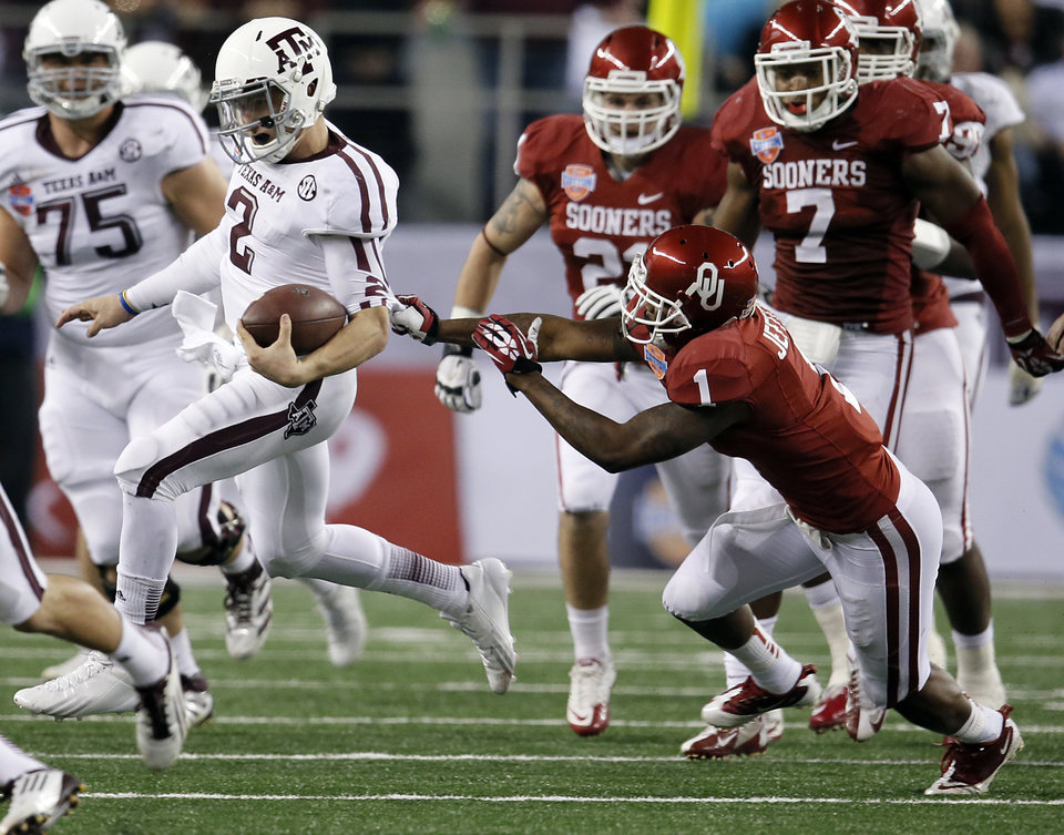 Photo - Texas A&M's Johnny Manziel (2) runs past Oklahoma's Tony Jefferson (1) during the college football Cotton Bowl game between the University of Oklahoma Sooners (OU) and Texas A&M University Aggies (TXAM) at Cowboy's Stadium on Friday Jan. 4, 2013, in Arlington, Tx. Photo by Chris Landsberger, The Oklahoman
